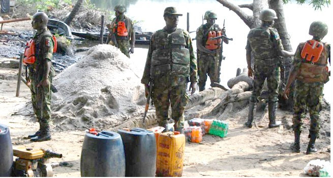 Two Soldiers WoundedAsSoldiers Raid Oil Bunkering SiteInRivers State(Photos)