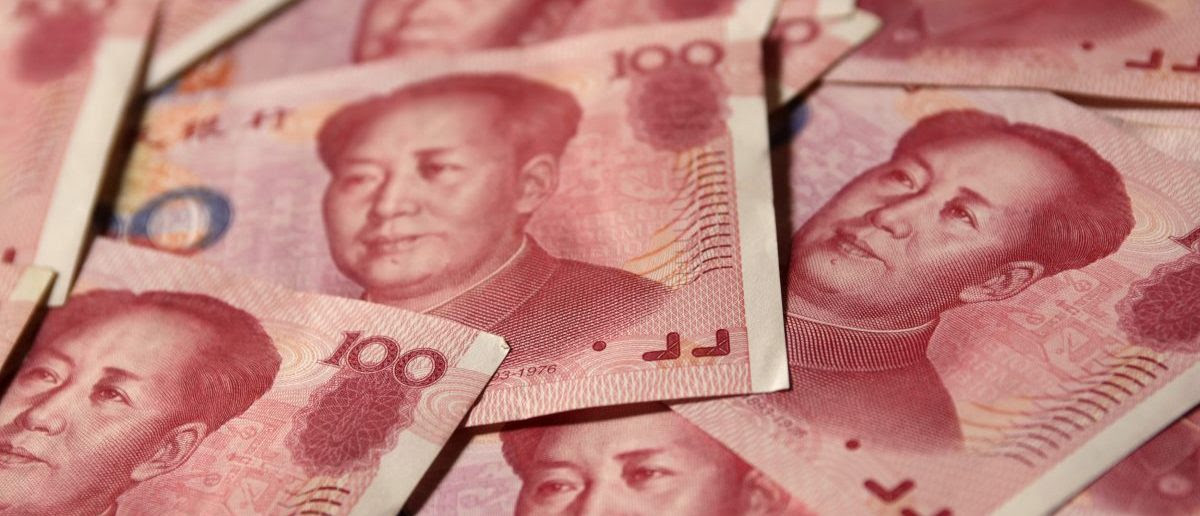 Yuan banknotes are seen in this illustrative photograph taken in Beijing September 19, 2010. China will not repeat Japan's mistake of the 1980s and let its exchange rate surge in response to foreign pressure, Li Daokui, an adviser to the People's Bank of China, said on Sunday. REUTERS/Petar Kujundzic