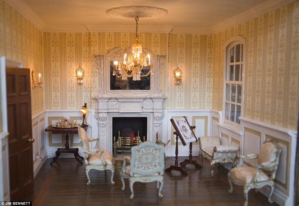 Detailed: The drawing room contains real electric lights and a fire powered by a mini smoke generator