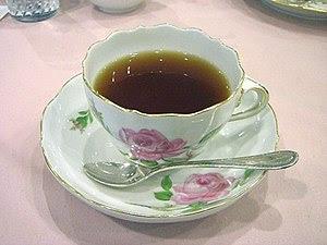 Tea in a Meißen pink-rose teacup