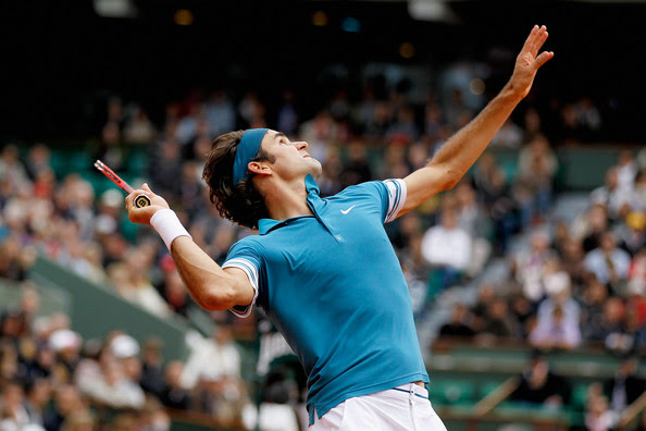 Roger Federer of Switzerland serves during the men's singles fourth round match between Roger Federer of Switzerland and Stanislas Wawrinka of Switzerland at the French Open on day eight of the French Open at Roland Garros on May 30, 2010 in Paris, France.