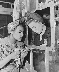 WWII-era photo showing Dora Miles and Dorothy Johnson at Douglas Aircraft Co. plant in Long Beach, CA.
