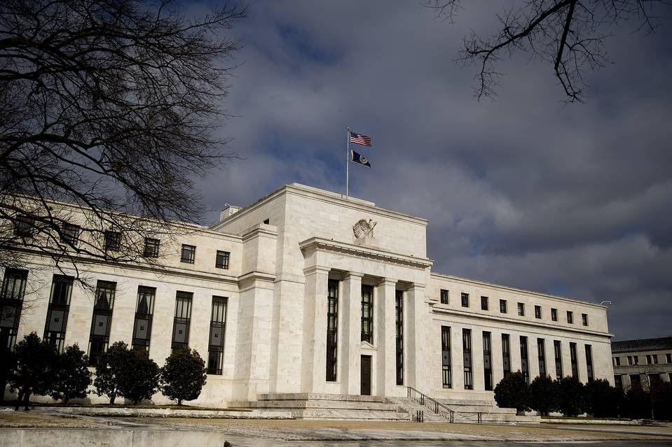 A U.S. flag flies on top of the Federal Reserve building in Washington, D.C.