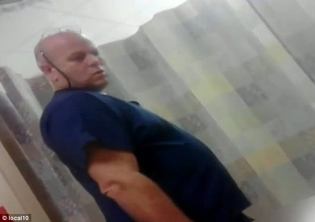 Shocking: This is the moment ER technician Rene Martinez, 51, allegedly sexually assaulted a 38-year-old patient as he lay in a bed at Palm Springs Hospital in Hiaeleah, Miami-Dade County, Florida, in September