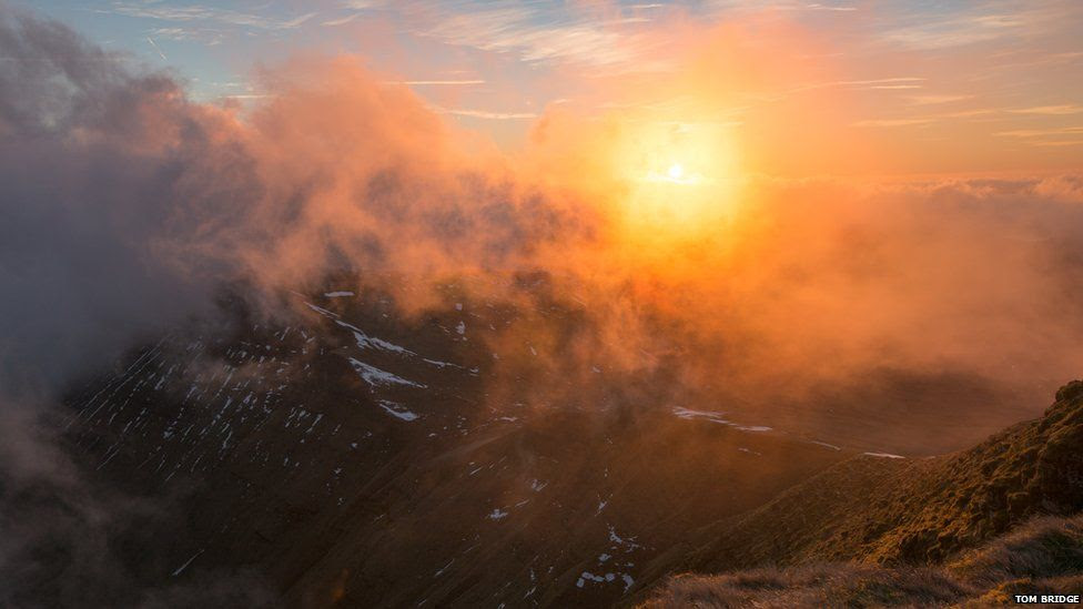 Sunrise over misty mountains