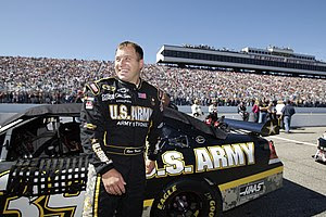 English: Ryan Newman stands beside his Number ...