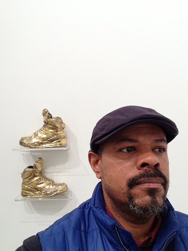 Self-portrait in front Gary Simmons' artwork