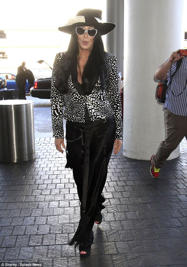 Spotty: The 69-year-old singer and actress took a walk on the wild side in a leopard print blazer, the centrepiece of her monochrome ensemble