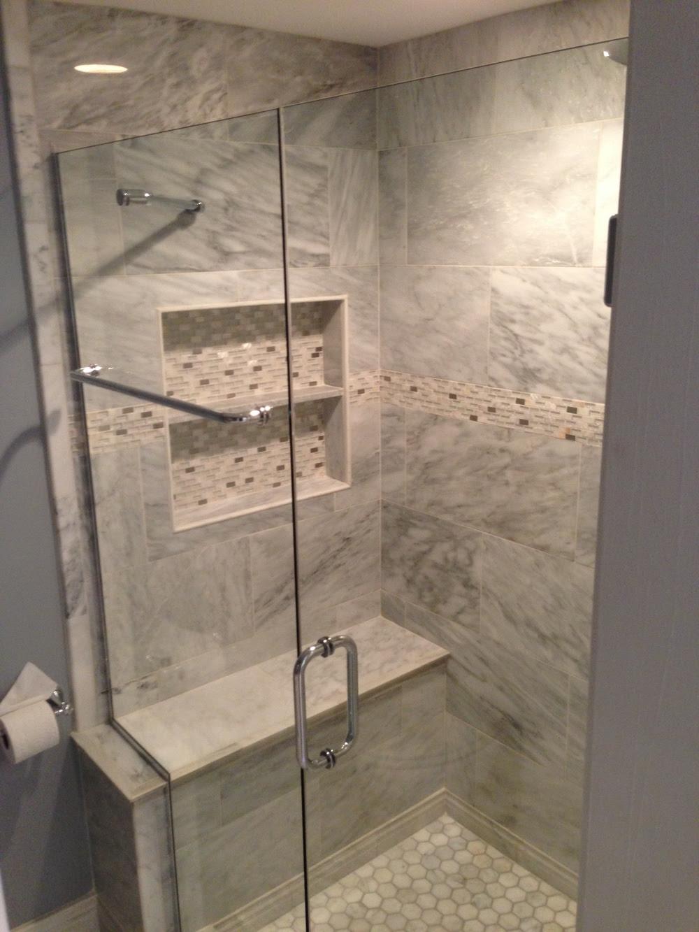 Frameless+shower+door+over+bench