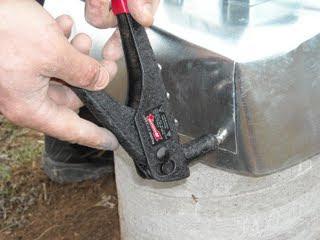 Using Rivet Tool on Concrete Pier Homemade Termite Shield
