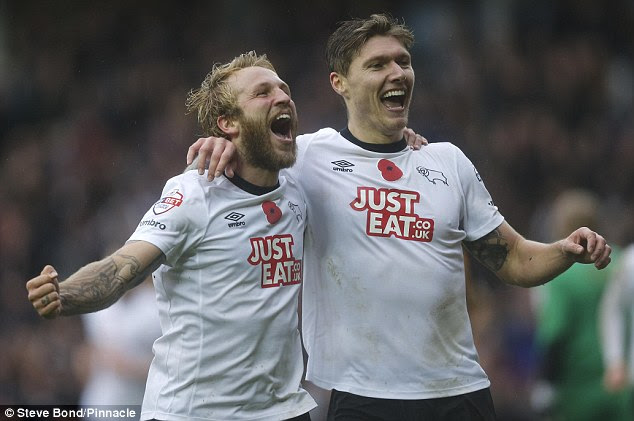 http://i.dailymail.co.uk/i/pix/2014/11/08/1415457240039_wps_28_Goal_celebration_by_Derby.jpg