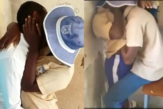 Secondary school students spotted passionately making out in class (video)