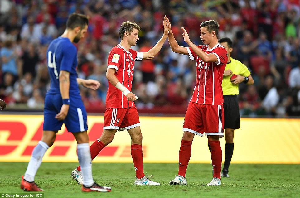 Marco Friedl, the Austrian youngster, congratulates Muller after the Bayern captain made it 3-0 to the Germans