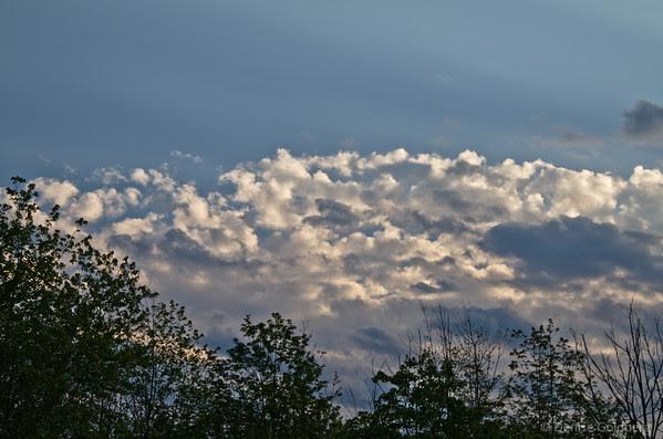 setting sun bathing clouds in light
