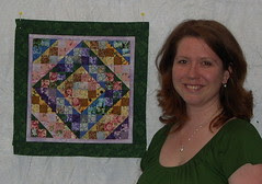 Krista and her miniature Carolina Byways quilt