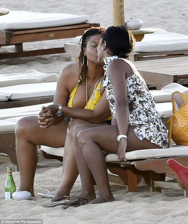 Kiss me quick! The affectionate couple shared smooches as they kicked back on loungers