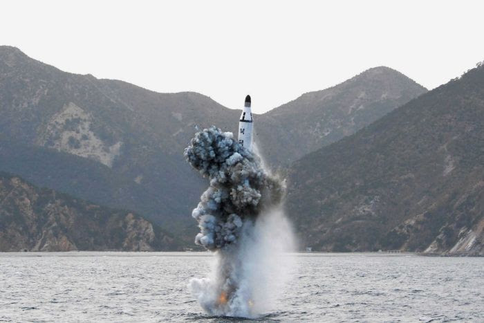A ballistic missile launches out of the water.