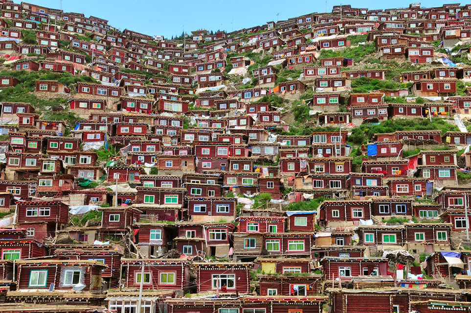 houses homes stacked hill tibet
