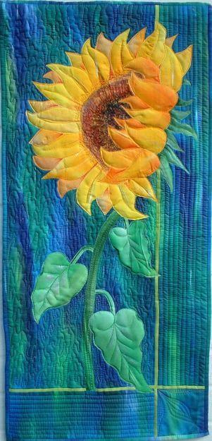 Sunflower by Maureen Thomas Gorgeous use of color contrast and integration of quilting into the design aquiltartist.com