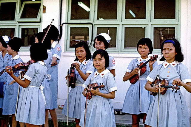Vietnamese children's orchestra at hospital. All the children had both their mother and father killed in the war