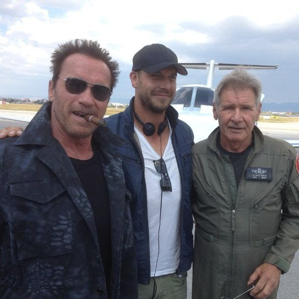 Arnold Schwarzenegger, director Patrick Hughes, and Harrison Ford on the set of The Expendables 3.
