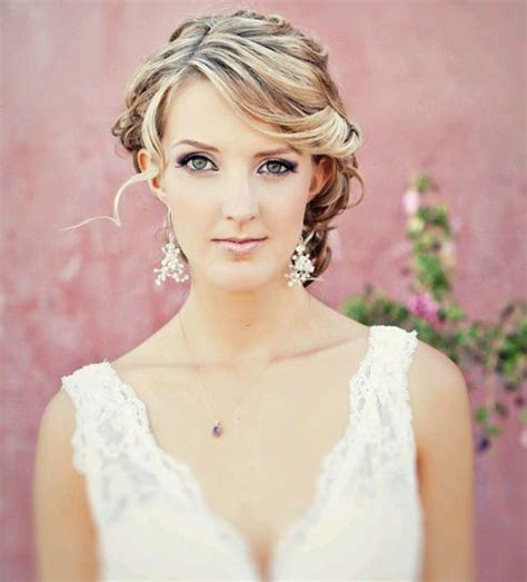 The bride is wearing lovely triangular beaded earrings