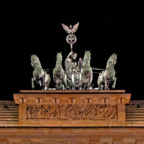 "restored quadriga atop Brandenburg Gate ►pale-verdigris gateway build-up (""horses'-herma"") in gloomy night◄"