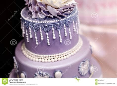 Purple Wedding Cake Decorated With Flowers Stock Image