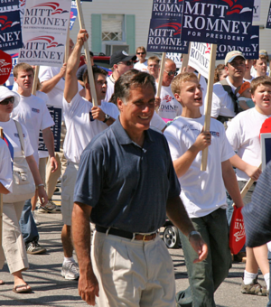 Mitt Romney surrounded by supporters during th...