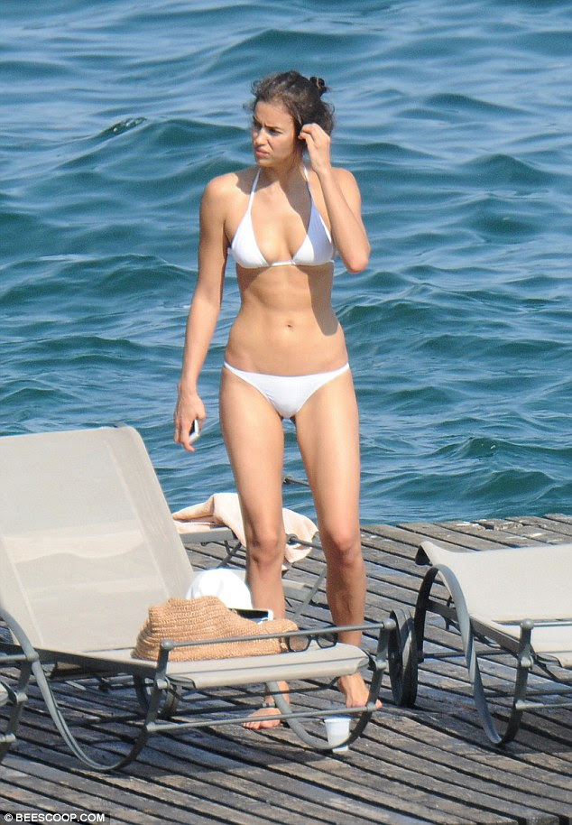 Perfect tan: The sun-kissed beauty achieved the perfect golden glow during her holiday