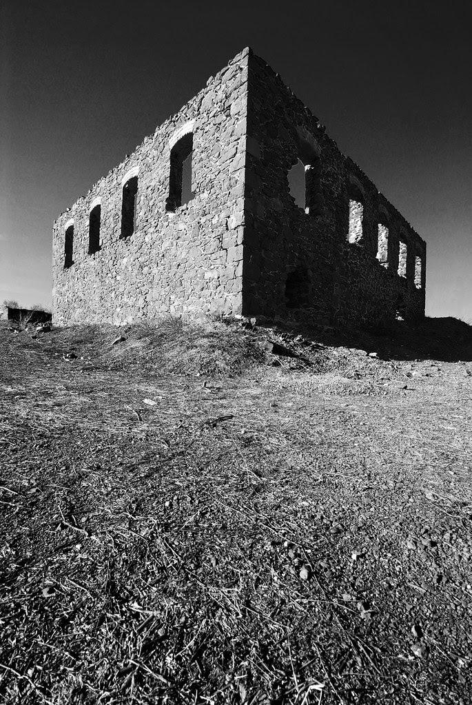 A stone ruin in the sunlight.