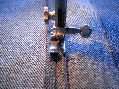 Sew down seams.