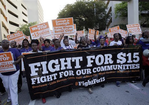 Protestors march in       support of raising the minimum wage to $15 an hour / AP