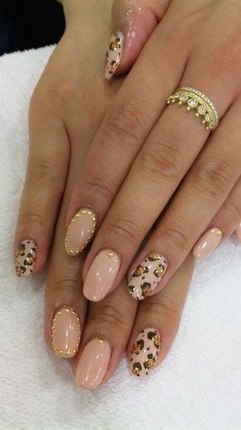 pastel pink and leopard nail design