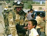 Black Watch trooper with Iraqi boy remembering Robinson's botched clearance
