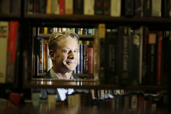 Ralph Lewin, Mechanics' Institute executive director, poses for a portrait in the library at the Mechanics' Institute on Monday, September 28, 2015 in San Francisco, Calif.