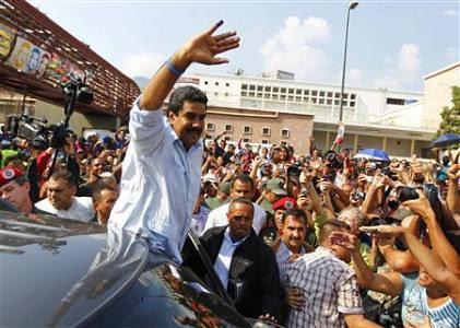 President Nicolas Maduro waves to supporters after voting in the national elections. He won re-election on April 14, 2013. by Pan-African News Wire File Photos