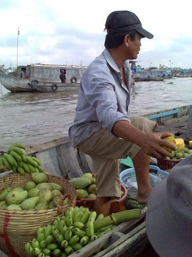 Selling fruit at Cai Rang Floating Market
