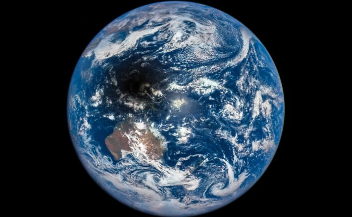 The Moon's shadow is cast across Indonesia in this view from the DSCOVR spacecraft, March 9, 2016. (Courtesy of the DSCOVR EPIC team.)