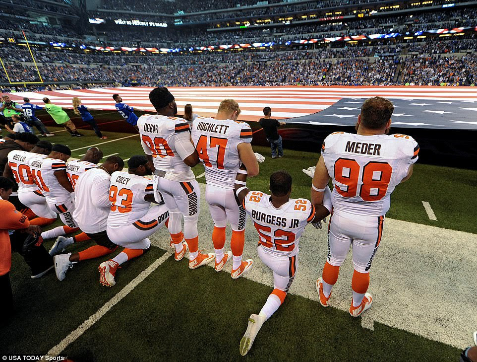 Some members of the Cleveland Browns team kneel while the National Anthem is played before the start of their game against the Indianapolis Colts at Lucas Oil Stadium in Indianapolis on September 24. Colts fans booed the protest against US president Donald Trump and Browns fans supporting the Republican brought sings pledging their allegiance