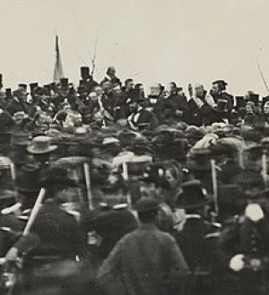 One of two confirmed photos of Abraham Lincoln (highlighted in the sepia color) at Gettsyburg taken just about noon. via Wikipedia.