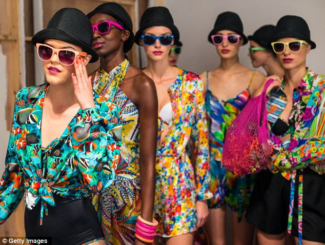 Prints charming: Models backstage at the Caroline Charles show on day one of London Fashion Week