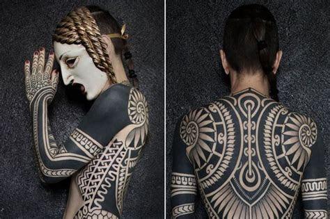 woman covered head toe huge intricate tribal