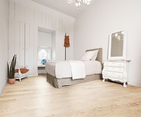 Cream laminate flooring combined with white bedroom furniture