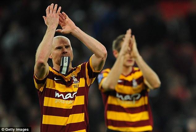 Despair: Bradford City captain Gary Jones applauds the fans after their crushing loss