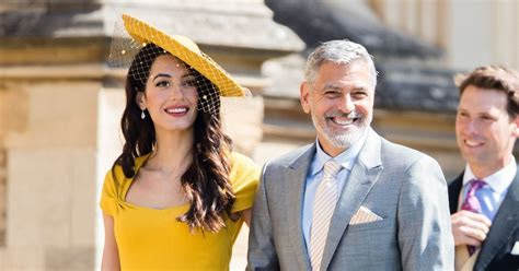 Here's Why Amal Clooney's Royal Wedding Outfit Cost Over