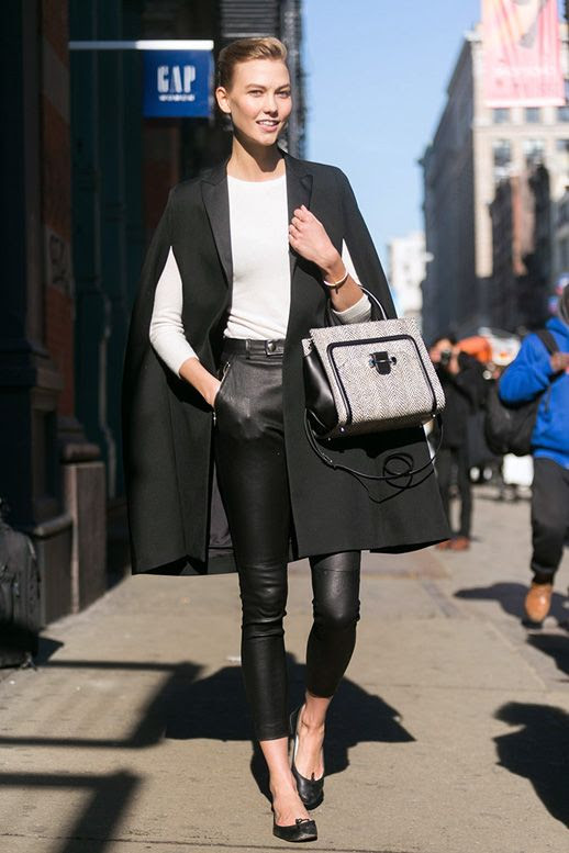 LE FASHION BLOG MODEL OFF DUTY KARLIE KLOSS NEW YORK FASHION WEEK BLACK CAPE COAT WHITE KNIT SWEATER HIGH WAIST CROPPED LEATHER PANTS BALLET FLATS BLACK WHITE PRINT SATCHEL BAG MODEL STYLE VIA MODELS.COM 2 photo LEFASHIONBLOGMODELOFFDUTYKARLIEKLOSSCAPECOATLEATHER2.jpg