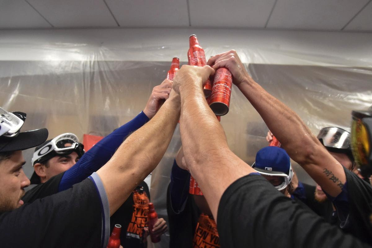 Mets celebrate with beer Slip N' Slide in clubhouse after NLDS win over Los Angeles Dodgers