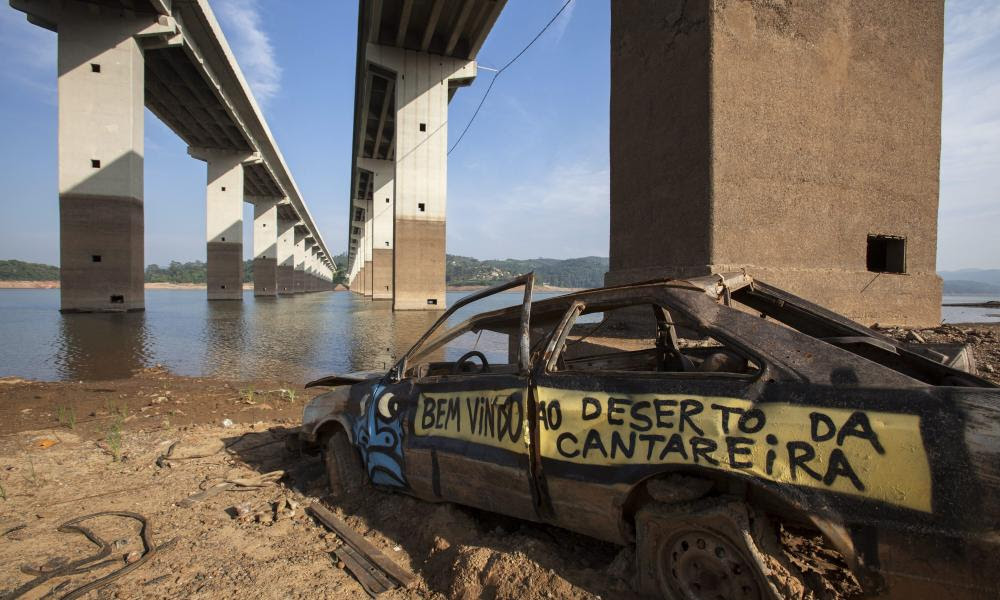 'Welcome to the Cantareira desert' is written on a car which was once submerged in water, at the Atibainha dam.