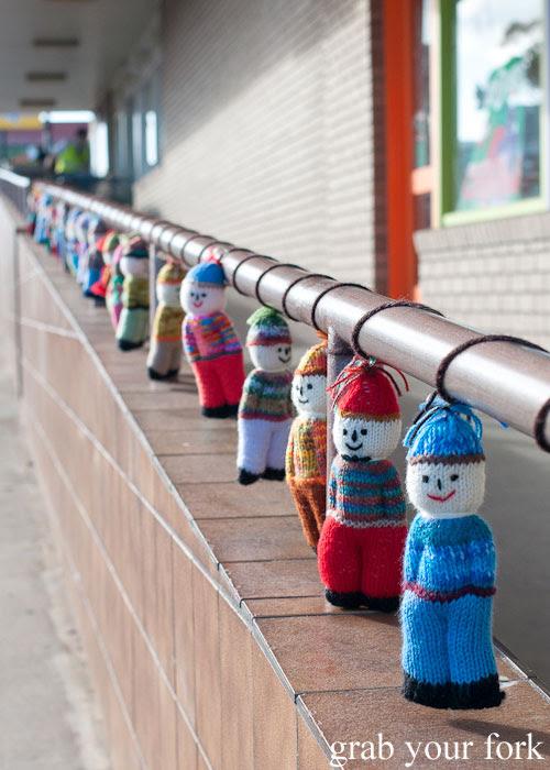 Yarn bombing dolls at the supermarket, Kingscote, Kangaroo Island